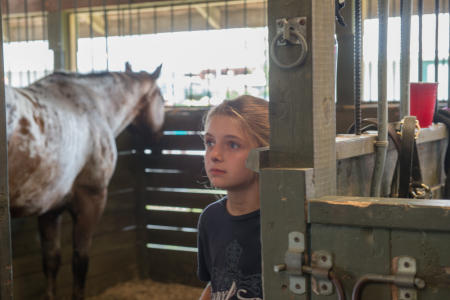Young girl in Stable with horse  Dutchess County Fair