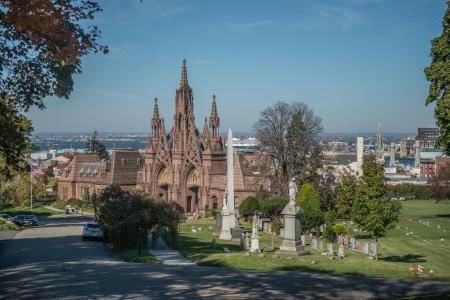 Landmarked Brownstone Cemetery gates in Gothic Revival style